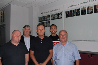 L-R Huw Cooze (Supporter Director); Nigel Hamer (Trust Secretary); Huw Jenkins ( Swans Chairman): Lee Trundle (Swans Club Ambassador); Viv Williams ( Trust Board Member and Project Manager)