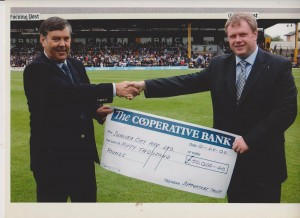 Nigel Hamer hands a cheque to David Morgan