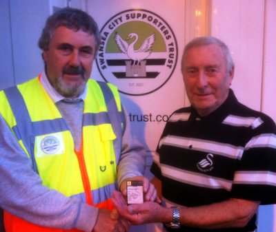 Wendall is pictured receiving his prize from Trust Board member, Alan Lewis